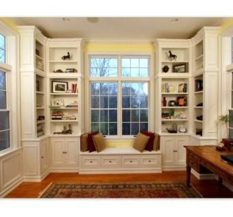 Living room / office area: window seat and corner bookshelves