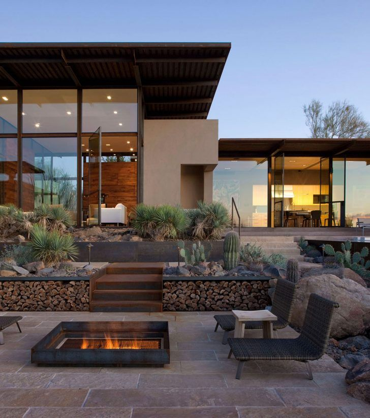 frontyard patio with xeriscape cactus succulent garden and gass firepit