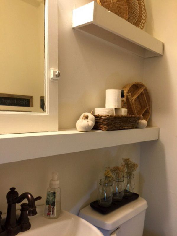 Full Shelf Under Mirror With Floating Shelves Above Toilet