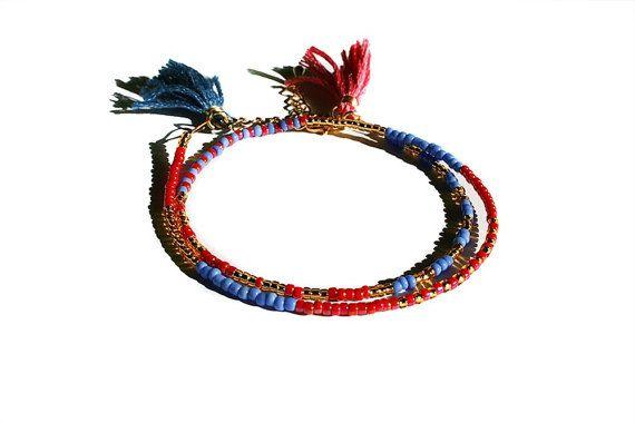 Beaded wrap women friendship bracelet, tassel bracelet, blue red and gold  seed bead modern bracelet:  Delicate wrap bracelet with red blue and gold seed beads. The bracele... #handmade #jewelry #boho #etsy #epiconetsy #shopping #shopsmall #jewelryonetsy #etsyseller #crochet