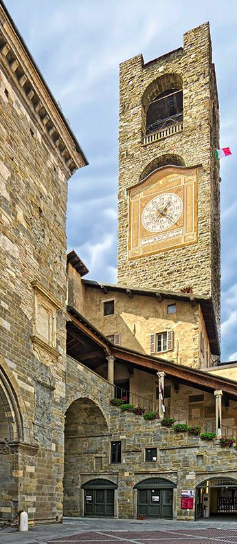 Clock tower in Bergamo, Italy - photo by Giuseppe, via Flickr; at Piazza Vecchia (Old Public Square) ... also see: https://www.flickr.com/photos/36017700@N02/4529976877/