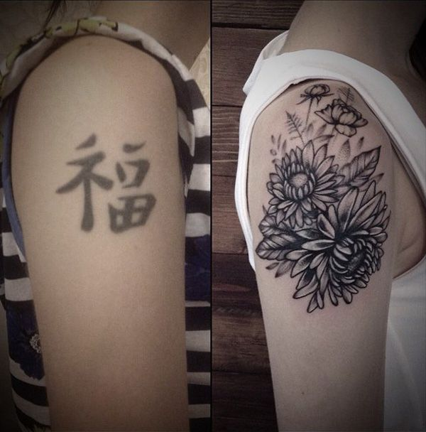 Flower cover up tattoo - The old tattoo are Chinese characters but seeing as they aren't as dark as they once might have been, it could be easy to cover it up without using too much shades and shadows. The darker parts of the new tattoos are strategically placed on the lines that are harder to conceal. The result is actually pretty impressive.
