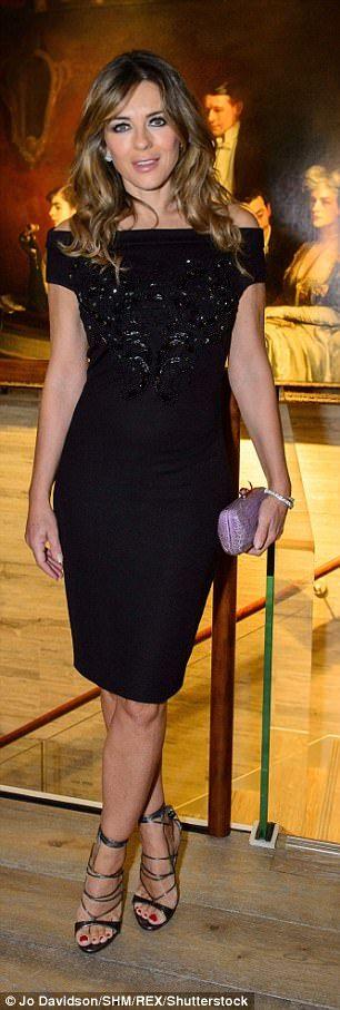 Elizabeth Hurley is a vision in a figure-hugging dress