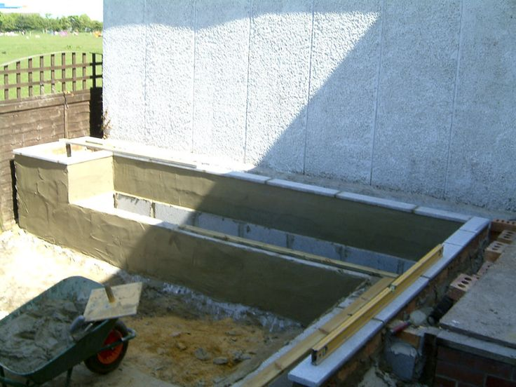 After removing the lawn and soil we added a membrane and compacted hardcore stone level over the area.  We then built the seating area, which was built from concrete blocks with the fronts being rendered and the tops finished with granite stone pieces.