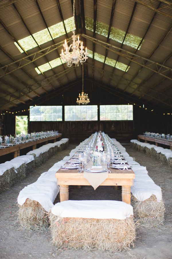 Fun barn wedding with haybale seating | photo by Jessica Oh Photography