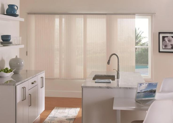 Sliding panel blinds are great for large windows and are easy to operate to create the perfect view. #BudgetBlinds