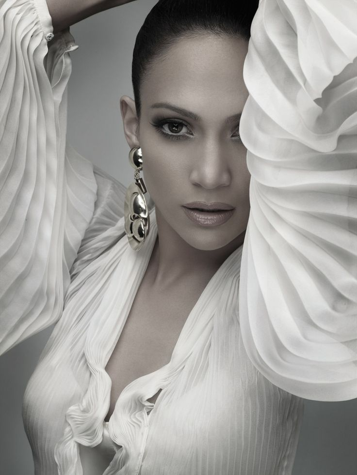 Jennifer Lopez. ...even if she cant sing, shes still a bad bitch. :)