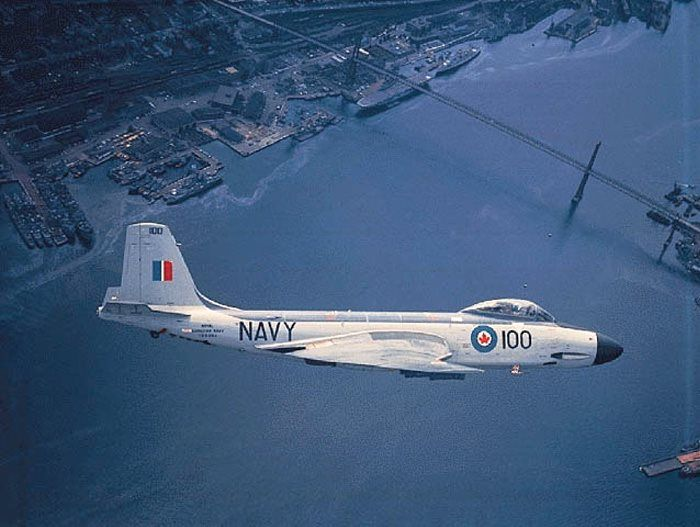 Only jet fighter to fly for Royal Canadian Navy was F2H-3 Banshee. Here a Banshee banks hard over Halifax harbour