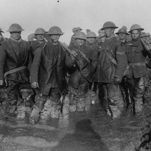 Soldiers standing in mud, France