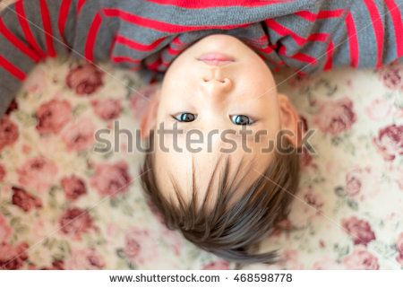 Thai baby boy laying on sofa, Close up head with up side down direction