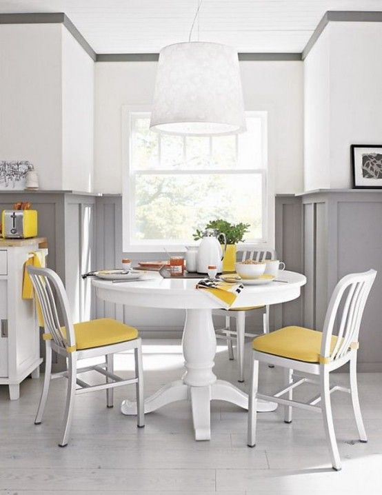 Accents of yellow work so lovely with the dramatic gray wainscot in dining area | DigsDigs