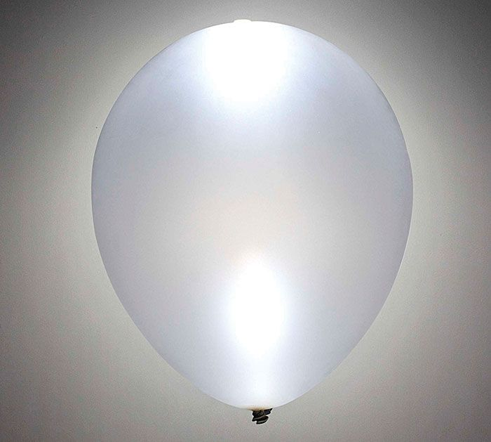 Add a bunch of Silver LED Lite-A-Loon™ Balloons to your next nighttime get together for an extra glowing ambiance! #burtonandburton #litealoon #LEDballoons #partydecor