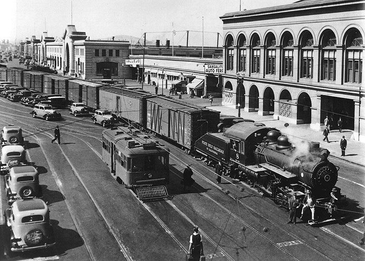 San Francisco Beltline Railroad. In this photo taken July 6, 1938, the E-Embarcadero streetcar line is running alongside the state-owned freight line.