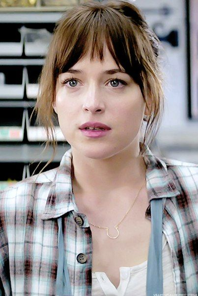 """You look beautiful, Ana,"" I assure her.She is wearing a burgundy and white plaid button down shirt that is open to show a white blouse and dark blue jeans. Her hair is pent up off of her shoulders behind her.  ""Tha…thank you…Um…wa..what are you doing here,"" she says to me. ."
