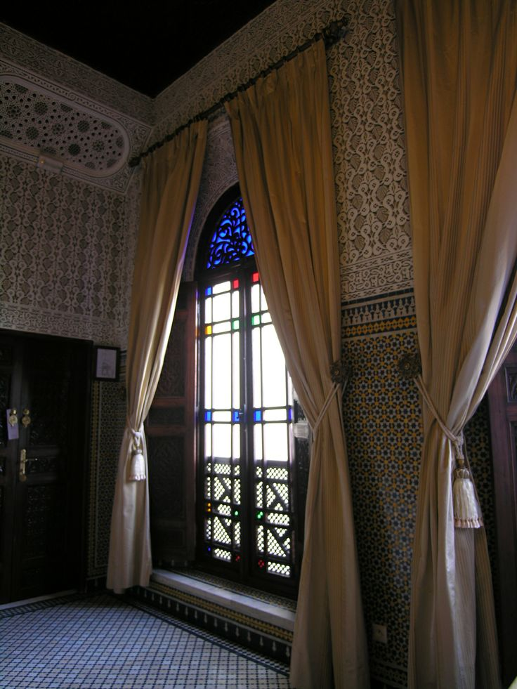 Floor to ceiling windows with stained glass let light from the central courtyard in to the rooms, making they light and airy. The high ceilings keep the rooms cool in the hot summers