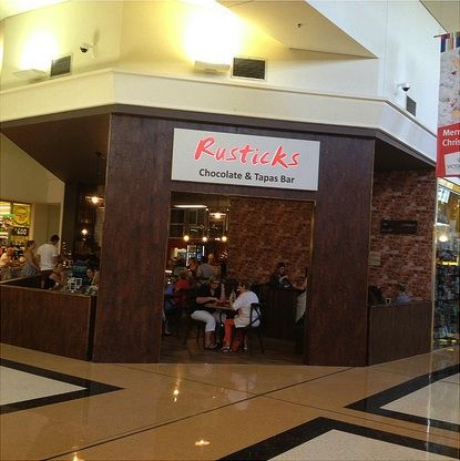 Rusticks Chocolate & Tapas Bar in the Victoria Point Shopping Centre (next to Woolworths). The coffees are not expensive and a good place to have your chocolate fix. Victoria Point is (east of Brisbane, Australia).