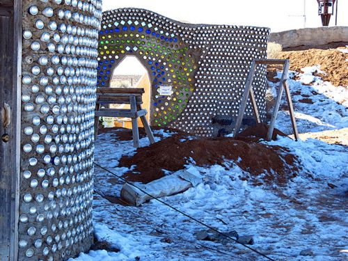 Earthships …awesome EcoSpirit // The Ultimate in Reclaim - Recycle - Reuse - Relive - // Cans and colored glass bottles used in mud walls