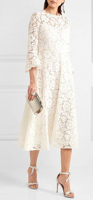 Valentino's $4,221 romantic midi dress is cut from ivory cotton-blend guipure lace that's intricately corded to outline its floral pattern. Made in Italy, this midi style has a nipped-in waist, gently flared skirt and stretch-silk georgette slip