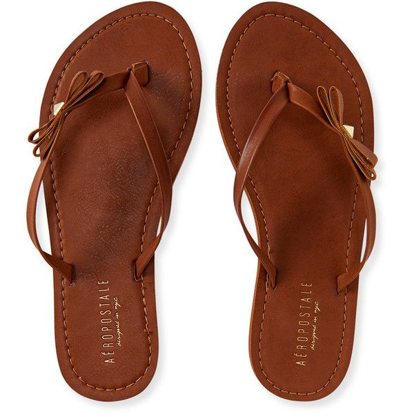 Aeropostale Bow Stud Flip-Flop ($10) ❤ liked on Polyvore featuring shoes, sandals, flip flops, sapatos, medium brown, aeropostale flip flops, flip flop shoes, brown flip flops, aeropostale sandals and synthetic shoes