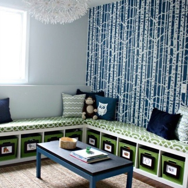 kids playroom, love the shelves as seats for kids to sit and read! Love the buckets underneath for organization of toys.