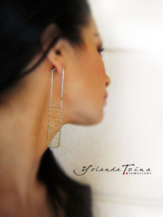 Long 925 silver earrings woven with a brass wire. by YolandaTzina