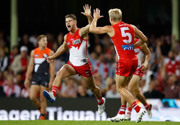Isaac Heeney Photos Photos - Tom Papley (left) and Isaac Heeney of the Swans of the Swans celebrate a goal during the 2017 AFL round 05 match between the Sydney Swans and the GWS Giants at the Sydney Cricket Ground on April 22, 2017 in Sydney, Australia. - AFL Rd 5 - Sydney v GWS