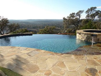 Beautiful natural stone infinity pool       www.romexcanadawest.com  natural stone  landscape design