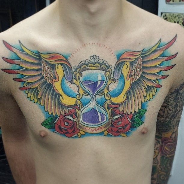 40 Wing Chest Tattoo Designs For Men: Cool Hour Glass Wing Tattoo On Chest For Men