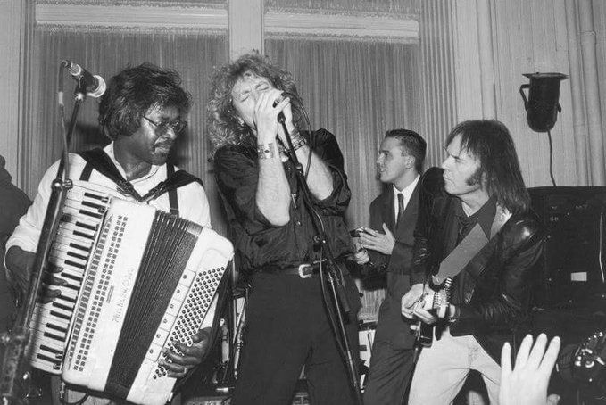 November 01, (1988) Musicians: Buckwheat Zydeco (r.i.p), Robert Plant (led zeppelin), Curt Smith and Neil Young performing at unidentified event. - twitter@robert plant, ©Getty image