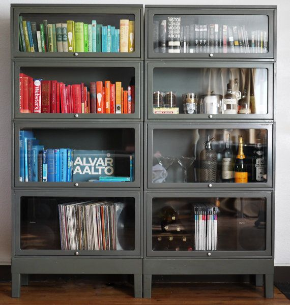 We've got a single stack of four and have been so lost on what to do with them. Perhaps this will lend some inspiration? Vintage Steel Barrister Bookcases