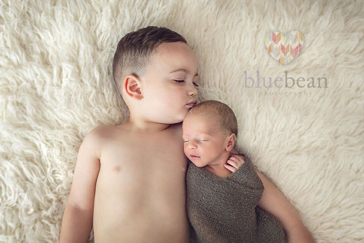 Newborn and his 2 year old brother sleeping on a flokati rug  Blue Bean Photography ~ Newborns www.bluebeanphotography.co.uk www.newbornphotographycoventry.co.uk