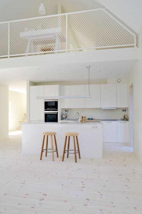 Lofty Swedish house with a concrete fireplace