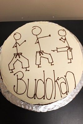 Super simple cake idea. Maybe we could draw some figures, add black belts, etc.
