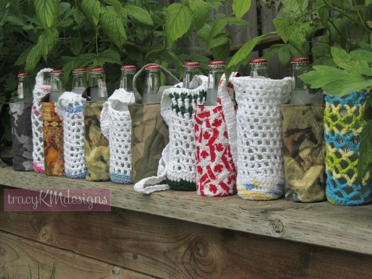 All my beer bottle/disposable waterbottle holders, as of July 10/15.  $12Cdn for the sewn ones, and $7 for the crocheted ones each.  The sewn ones are reversible.  Smirnoff not included!
