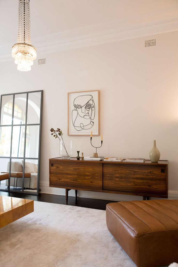 BROOKE TESTONI The Niels Otto Moller sideboard. The leather chaise from Timothy Oulton. MCM house mirror. One-line illustration on the wall is from sweet Christiane Spangberg.