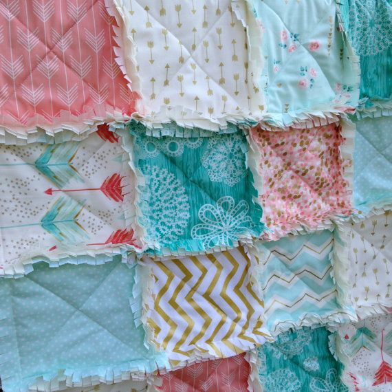 I loved the coral/turquoise arrow fabric and knew that I wanted to make a quilt to showcase this beautiful fabric by artist Emily Sanford over at