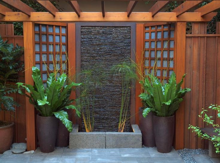 stained wooden arbor with sleek aesthetic~~sleek arbor with urns~~I love the urn plants! Gotta find out what they are as I need these in my garden!!
