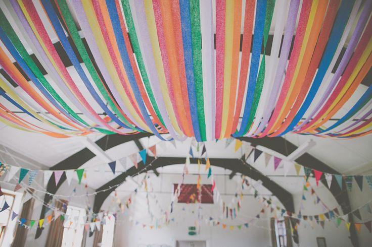 Rainbow Bunting Crepe Paper Streamers Crafty Colourful Village Hall Wedding http://jamesmelia.com/