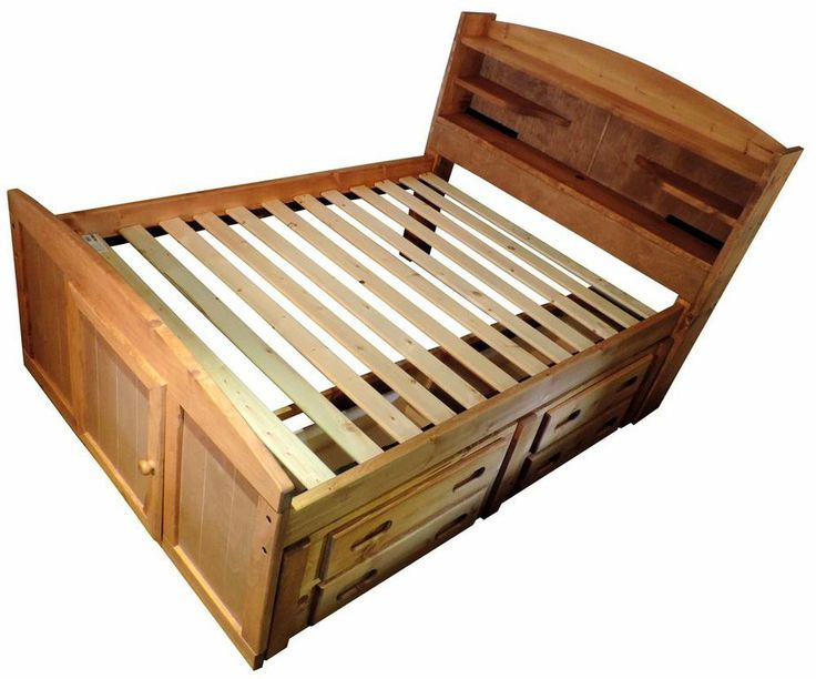 Platform bed with slats. Storage bed in action. Captains Bedroom Set in Amber Wash by Rustic Classics on www.GoWFB.ca. Four under-bed storage drawers provide room for clothes, toys and other items. Can include platform twin bed or full bed, dresser, mirror, nightstand, chest, desk & hutch, bookcase and a toybox. #furniture #canada #wholesale #kidsfurniture #bedroomsuite #storagebed