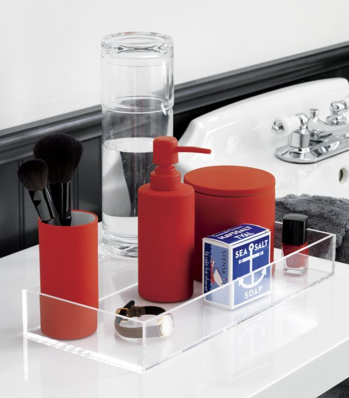 Guest bath, maybe? touch of pop.  Tactile storage staples pop bold in smooth-to-the touch orange rubber.  Bright idea for the bath.  Fun in the office, too. Stoneware with orange rubber coatingWipe with damp clothMade in China.