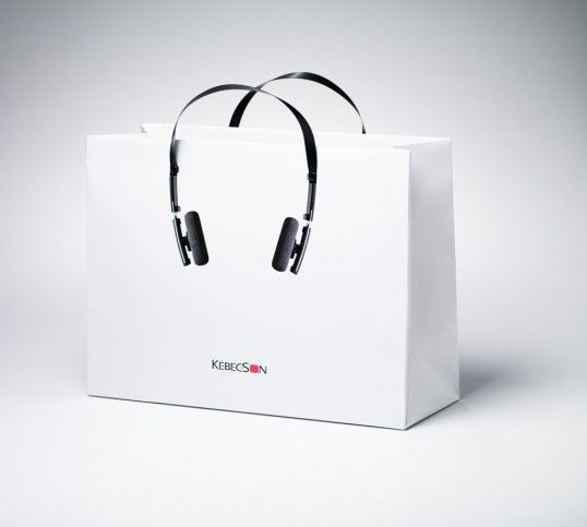 carrier bag based on headphones.  simple yet effective design.  the text under the headphones looks as though it is a face on the bag. I love the way this person has combines music and packaging.