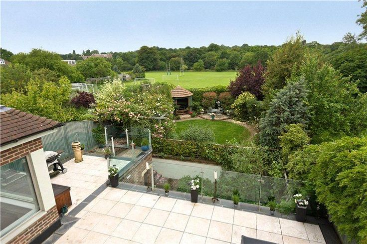 """http://www.johndwood.co.uk/property-for-sale/  A substantial detached 1930's family house in this favoured West Wimbledon location with views across and backing onto Wimbledon Common playing fields. The well presented accommodation is arranged over 4 floors and the property further benefits from a delightful south westerly facing rear garden and off street parking for several vehicles.<br> <a href=""""#"""" onclick=""""$('#longly').hide(200);$('#briefly').show(200);return false;"""" ..."""