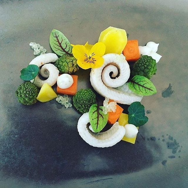 Dover sole, Romanesco broccoli in hazelnut butter, lime caviar, garlic mayonnaise, blue peppery leaves, yellow beet, carrot, and vene cress by @chefgunterpaffendorf. Plate by @tovariambiance #TheArtOfPlating
