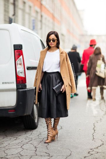 25 Ways to Wear Midi Skirts - over-the-shoulder camel coat worn with white t-shirt + leather midi skirt and gladiator heels  | StyleCaster