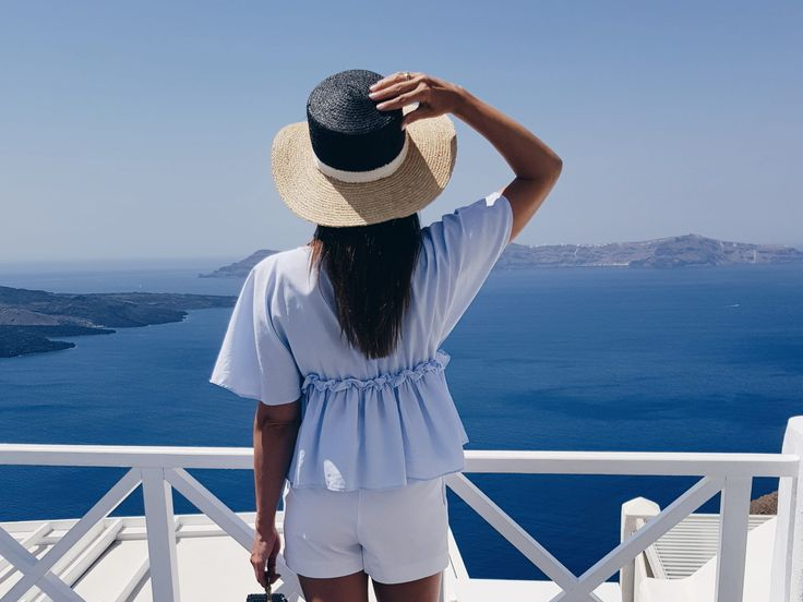 Perfect blue and white outfit matching with the deep blue sea.  Santorini Caldera view