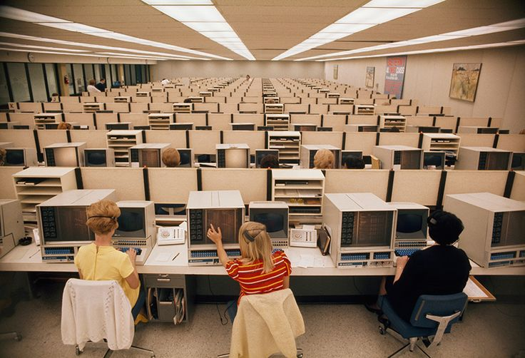Operators man computers at Eastern Airlines' reservations center in Miami, November 1970. Photograph by Bruce Dale, National Geographic
