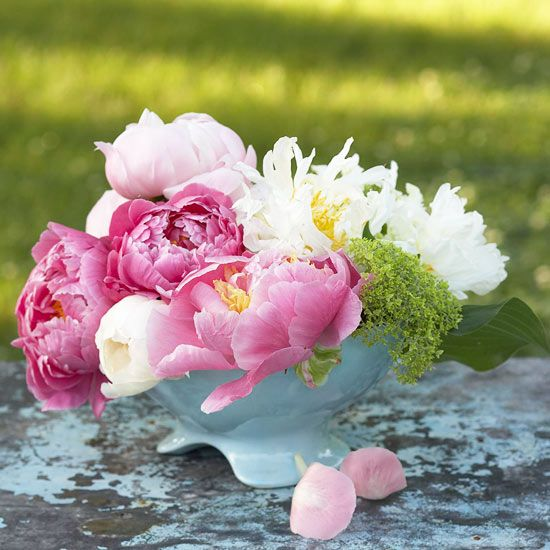 Bowl of Mother's Day Flowers: For a brilliant bouquet this Mother's Day, group an array of peonies in a low bowl from the kitchen cupboard, and display them in Mom's room or bathroom. Look for varying shades of pink, white, and purple peonies, and stick in some greenery for contrast.