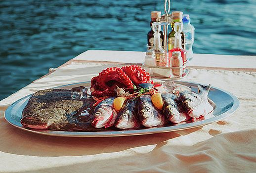 Fresh seafood plate in restaurant at sea by Nadya&Eugene Photography #FoodPhotography #Fish #SeaFood