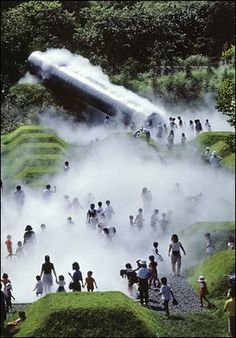 """Tokyo's Showa Kinen park """"which combines truncated pyramids with a 32-foot steel tube that emits artificial fog every 15 minutes. Atsushi Kitagawara Architects collaborated with the artist Fujiko Nakaya to create this mist-shrouded world, where the fog shifts and clears just as it does in real life. """""""