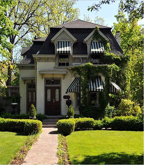 I love the black and white exterior colors, I love the awnings and the landscape is gorgeous.